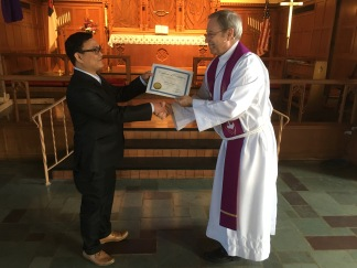 Bhim completing his course on Christian Doctrine receives his certificate of completion.